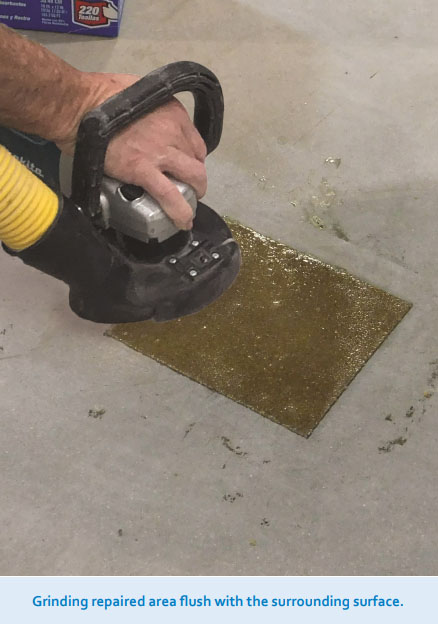 Grinding repaired area flush with the surrounding surface.